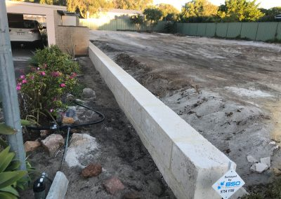 Allareas Earthmoving - Retaining Walls - Completed Reconstituted Limestone Wall